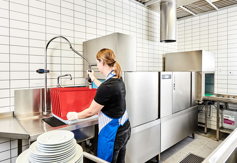 The Winterhalter rack conveyor dishwasher in the Avira company cafeteria