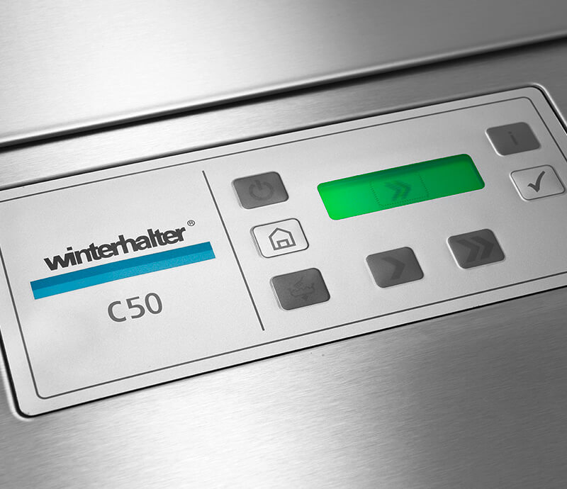 Language-Neutral display on Winterhalter C50 rack conveyor dishwasher